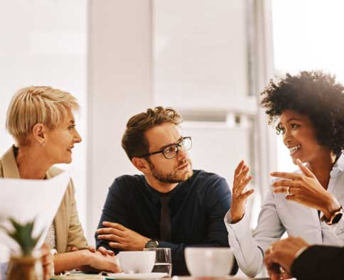 Co-workers talking at conference table